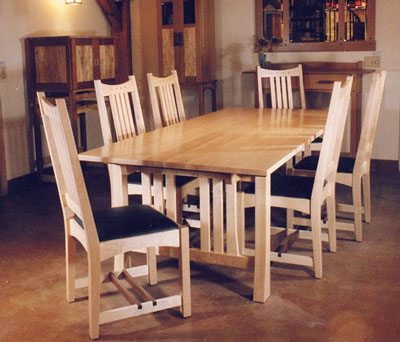 CONTEMPORARY CRAFTSMAN DINING SET. Wood: Table: Maple And Walnut. Seats 6.  Chairs: Maple And Walnut With Leather Seats.